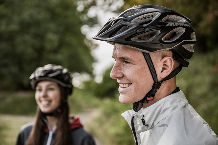 man and women in cycling helmets